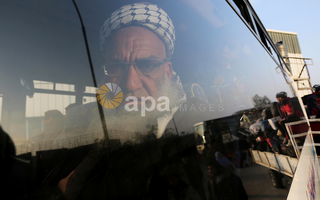 Palestinians sits in a bus as they wait for travel permits to cross into Egypt through the Rafah border crossing after it was opened by Egyptian authorities for humanitarian cases, in Rafah in the southern Gaza Strip on February 11, 2017. Photo by Ashraf Amra