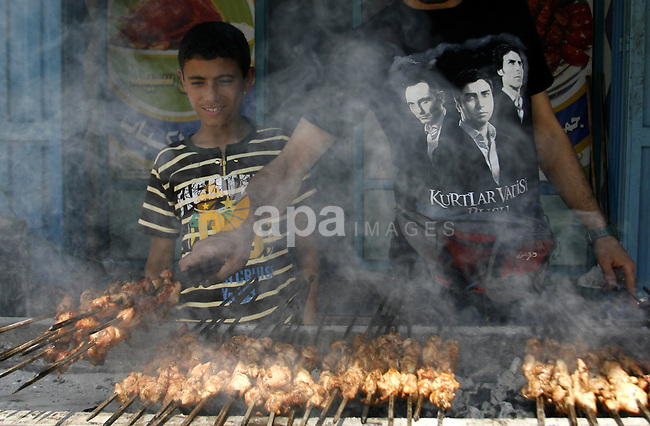 "A Palestinian vendor sells grilled meat ""Shish Taouk"" in his shop at a market in Rafah in the southern Gaza Strip, on June, 04, 2012. Photo by Eyad Al Baba"