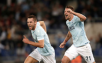 Calcio, Serie A: Roma, stadio Olimpico, 20 settembre 2017.<br /> Lazio's Stefan De Vrij (l) celebrates after scoring with his teammate Sergej Milinkovic (r) during the Italian Serie A football match between Lazio and Napoli at Rome's Olympic stadium, September 20, 2017.<br /> UPDATE IMAGES PRESS/Isabella Bonotto