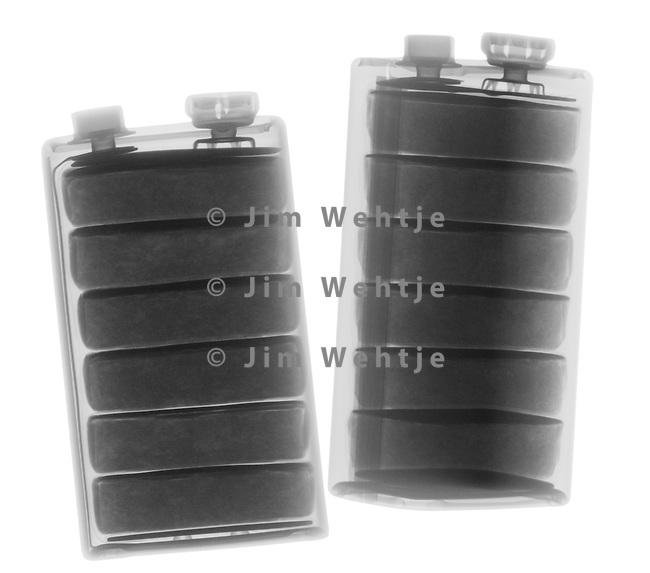 X-ray image of 9 volt batteries (black on white) by Jim Wehtje, specialist in x-ray art and design images.
