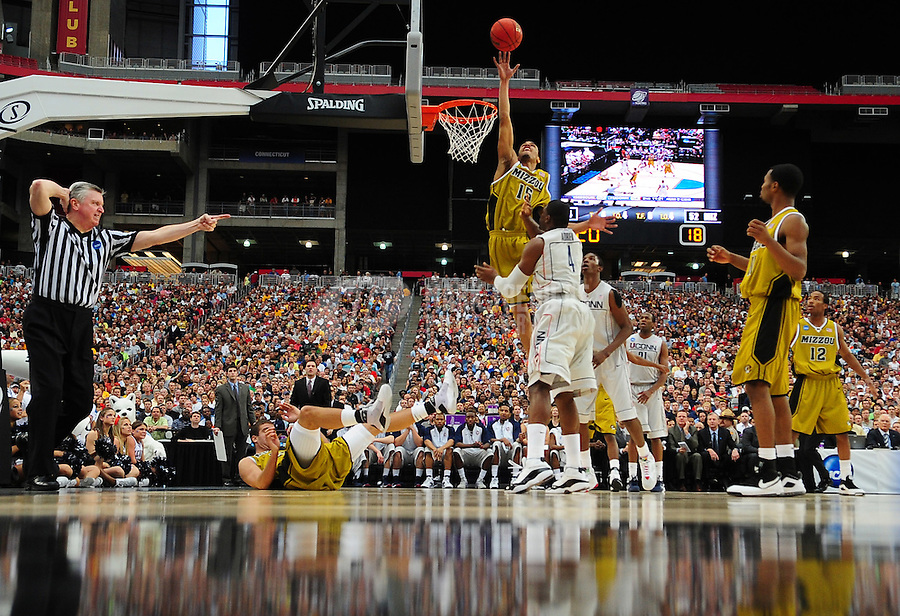 Mar 28, 2009; Glendale, AZ, USA; Missouri Tigers forward (15) Keith Ramsey blocks a shot against the Connecticut Huskies during the finals of the west regional in the 2009 NCAA mens basketball tournament at the University of Phoenix Stadium. The Huskies defeated the Tigers 82-75 to advance to the final four. Mandatory Credit: Mark J. Rebilas-