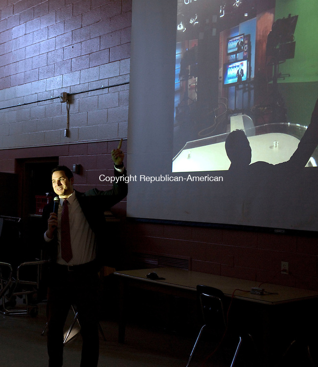 Wolcott, CT- 13 January 2016-011316CM01-  Dan Amarante, a meteorologist for Fox 61 speaks to fourth and fifth grade students at Wakelee School in Wolcott on Wednesday.  Amarante presented slide shows with various weather photographs, talked about his line of work and answered questions from the children.  Christopher Massa Republican-American