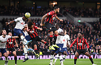 30th November 2019; Tottenham Hotspur Stadium, London, England; English Premier League Football, Tottenham Hotspur versus AFC Bournemouth; Serge Aurier of Tottenham Hotspur wins the header under pressure from Nathan Ake of Bournemouth  - Strictly Editorial Use Only. No use with unauthorized audio, video, data, fixture lists, club/league logos or 'live' services. Online in-match use limited to 120 images, no video emulation. No use in betting, games or single club/league/player publications