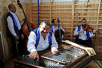 """Orchestra members of the Roma or gypsy theater Romathan set up in the gymnasium before a performance of """"Dwarf"""" at the Banske Elementary School with a Roma or gypsy majority student body in Banske, Slovakia on June 2, 2010."""