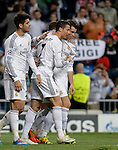 Real Madrid's Portuguese forward Cristiano Ronaldo celebrates during the UEFA Champions League football match Real Madrid CF vs Schalke 04 FC at the Santiago Bernabeu stadium in Madrid on March 18, 2014.  PHOTOCALL3000/ DP