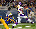 October 11, 2009 - St Louis, Missouri, USA - Vikings running back Adrian Peterson (28) scores a touchdown in the game between the St Louis Rams and the Minnesota Vikings at the Edward Jones Dome.  The Vikings defeated the Rams 38 to 10.  .