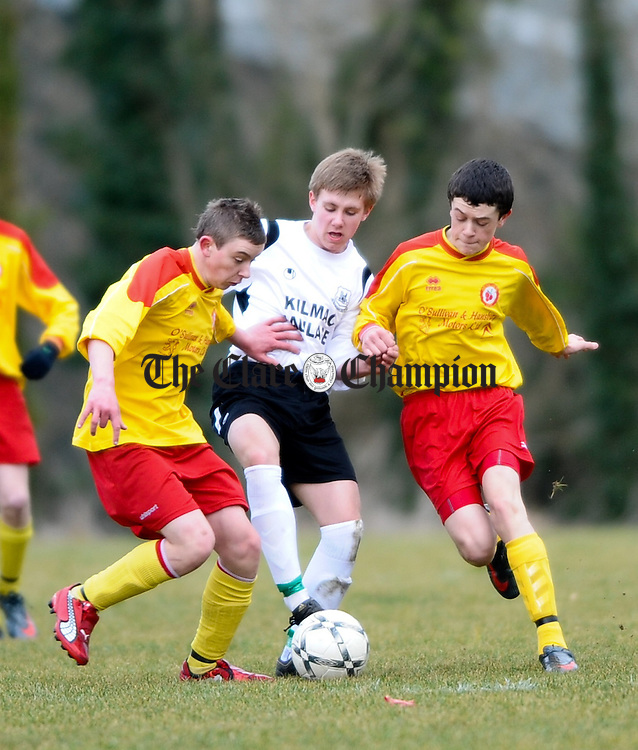 Avenue's David Conroy and Eanna Fenell close off their Kilmacrennan opponent during their U-14 National Cup game at Lees Road. Photograph by John Kelly.