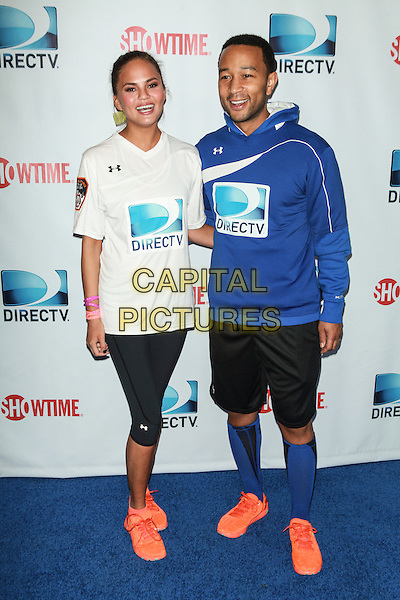 NEW YORK, NY - FEBRUARY 1: Chrissy Teigen, John Legend  attends the DirecTV Beach Bowl at Pier 40 on February 1, 2014 in New York City. <br /> CAP/MPI/COR<br /> &copy;Corredor99/ MediaPunch/Capital Pictures