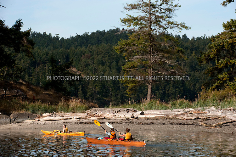 8/26/2009--Pender Island, British Columbia, Canada..Lisa Ochs (right) and  Heather Morrison (center) and Kelly Ovehovec, left, all from the United States, kayak off the beach at the Beaumont Marine Provincial Park. The three were kayaking around the Gulf Islands. ..©2009 Stuart Isett. All rights reserved.