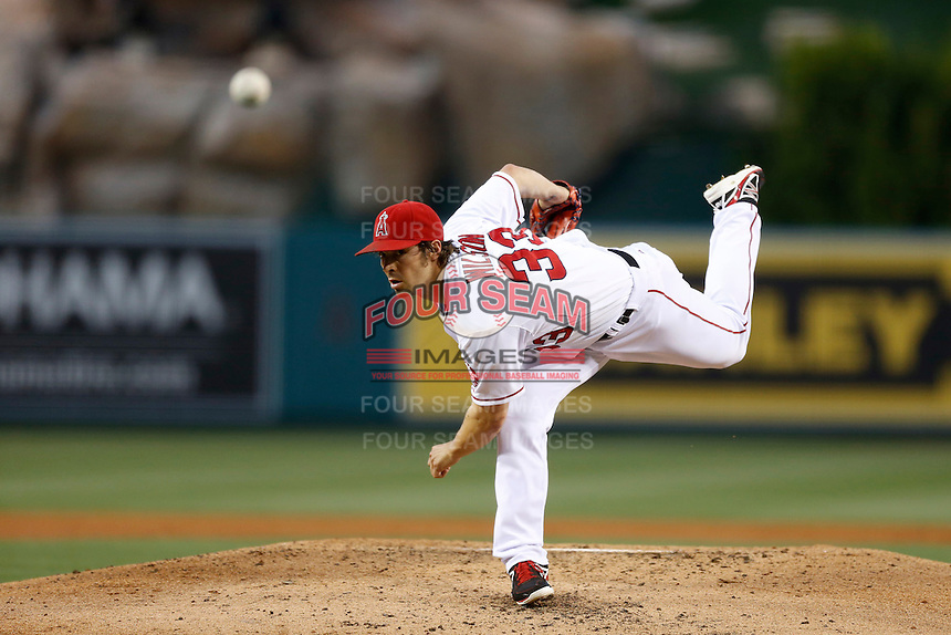 C. J. Wilson #33 of the Los Angeles Angels pitches against the Chicago White Sox at Angel Stadium on May 17, 2013 in Anaheim, California. (Larry Goren/Four Seam Images)