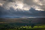 A farmhouse on moorland under grey skies in England