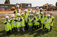 Richard Charman (left) and Martin Burton of Kier with Chris Frith (right) of the Education Advisory Body with Wainwright Primary Academy School Council pupils, turning the first sod at the ground-breaking ceremony to mark the start of works on their new school.