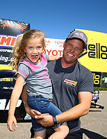 May 21, 2017; Topeka, KS, USA; NHRA pro mod driver Steve Jackson celebrates with his daughter after winning the Heartland Nationals at Heartland Park Topeka. Mandatory Credit: Mark J. Rebilas-USA TODAY Sports