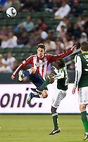 CARSON, CA – June 3, 2011: Chivas USA midfielder Ben Zemanski (21) goes high to pass the ball during the match between Chivas USA and Portland Timbers at the Home Depot Center in Carson, California. Final score Chivas USA 1, Portland Timbers 0.