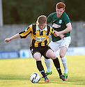 East Fife's Alan Cook holds off Hibs' Michael Richardson.