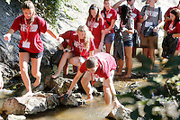 NWA Democrat-Gazette/DAVID GOTTSCHALK   Chris Sheldon (bottom center) makes his way down Clear Creek in Johnson with University of Arkansas R.O.C.K. Camp participants during a clean up Wednesday, August 12, 2015. R.O.C.K. Camp, Razorback Outreach for Community and Knowledge, is an extended orientation program for first year students  designed to aid incoming students in developing a diverse social network.