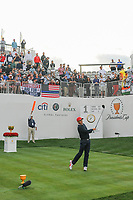 Rickie Fowler (USA) watches his tee shot on 1 during round 3 Foursomes of the 2017 President's Cup, Liberty National Golf Club, Jersey City, New Jersey, USA. 9/30/2017.<br /> Picture: Golffile | Ken Murray<br /> <br /> All photo usage must carry mandatory copyright credit (&copy; Golffile | Ken Murray)