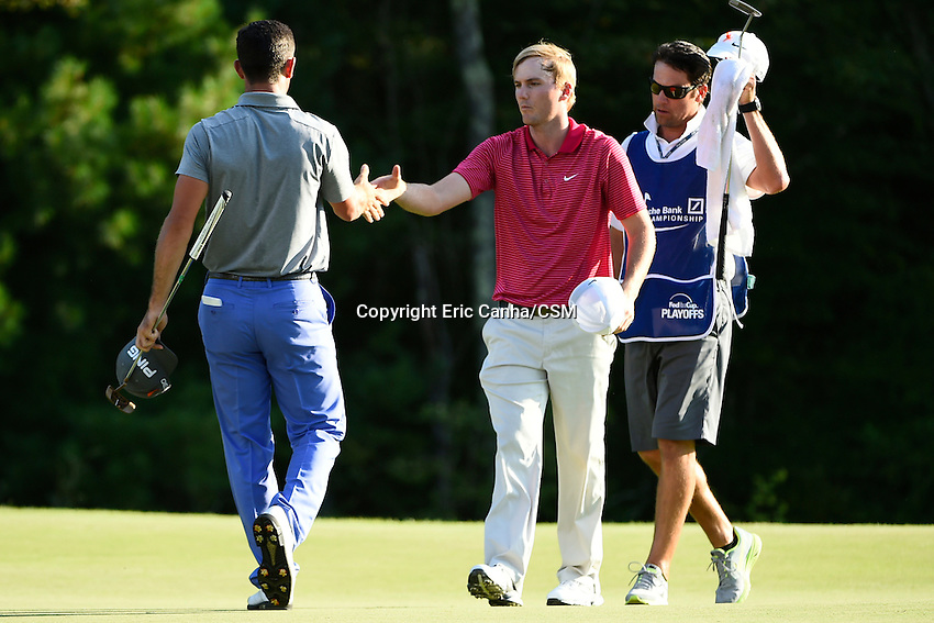September 1, 2014 -  Norton, Mass. - Billy Horschel (left) and Russ Henley (right) shake hands after the fourth round of the PGA FedEx Cup playoffs, Deutsche Bank Championship, held at the Tournament Players Club in Norton Massachusetts. Eric Canha/CSM
