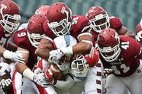 Sep 20, 2014; Philadelphia, PA, USA; Delaware State Hornets running back Malcolm Williams (2) is wrapped up by the Temple Owls defense at Lincoln Financial Field. Mandatory Credit: Derik Hamilton-USA TODAY Sports