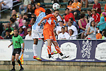 19 May 2012: Carolina's Brian Shriver (right) heads the ball under pressure from Puerto Rico's Richard Martinez (PUR) (3). The Carolina RailHawks and the Puerto Rico Islanders played to a 1-1 tie at WakeMed Soccer Stadium in Cary, NC in a 2012 North American Soccer League (NASL) regular season game.