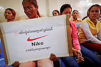 "Som Cheantha, a eight month pregnant garment worker cries and holds a sign during a gathering of workers at their union headquarters in Phnom Penh June 27, 2013. Som Cheantha cried for her husband, also a garment worker, who she said was arrested following a protest that turned violent at Sabrina (Cambodia) Garment Manufacturing Corp factory that produces clothing for U.S. sportswear company Nike. The sign reads ""We, all together, support Nike to put orders in Cambodia"". The garments industry has become by far Cambodia's biggest export earner, with shipments up 10 percent in 2012 to $4.44 billion. As investment in Cambodia's textile industry surges, so is labor unrest, putting pressure on suppliers to the world's big garment brands to raise wages and improve sometimes grim conditions in one of the last bastions of low-cost factories.   REUTERS/Damir Sagolj (CAMBODIA)"