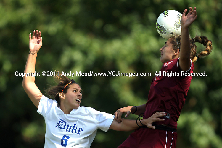 02 October 2011: Virginia Tech's Brittany Michels (right) heads the ball away from Duke's Callie Simpkins (6). The Duke University Blue Devils defeated the Virginia Tech Hokies 1-0 at Koskinen Stadium in Durham, North Carolina in an NCAA Division I Women's Soccer game.