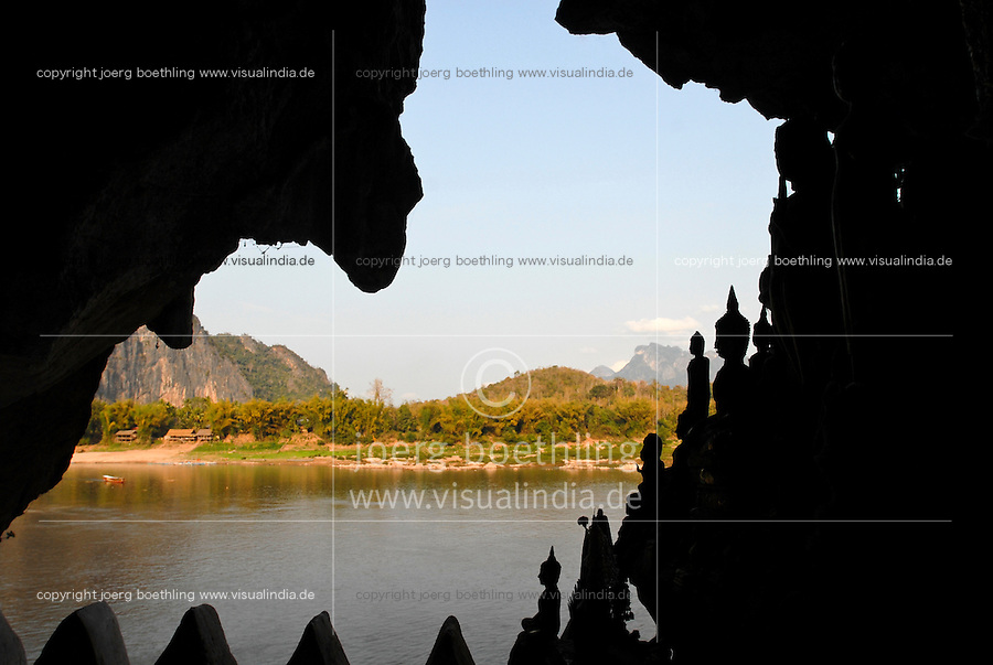 LAOS Luang Prabang, cave with buddhist shrine at Pak Ou where Nam Ou river meets the Mekong river / LAOS, Pak Ou Muendung des Nam Ou in den Mekong , Hoehle mit buddhistischem Tempel