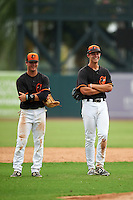GCL Orioles third baseman Frank Crinella (9) and shortstop Ryan Mountcastle (43) during a pitching change during the second game of a doubleheader against the GCL Rays on August 1, 2015 at the Ed Smith Stadium in Sarasota, Florida.  GCL Orioles defeated the GCL Rays 11-4.  (Mike Janes/Four Seam Images)