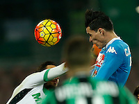 Napoli's Jose Callejon head the bakll and scores  during the  italian serie a soccer match,between SSC Napoli and Sassuolo    at  the San  Paolo   stadium in Naples  Italy , January 17, 2016