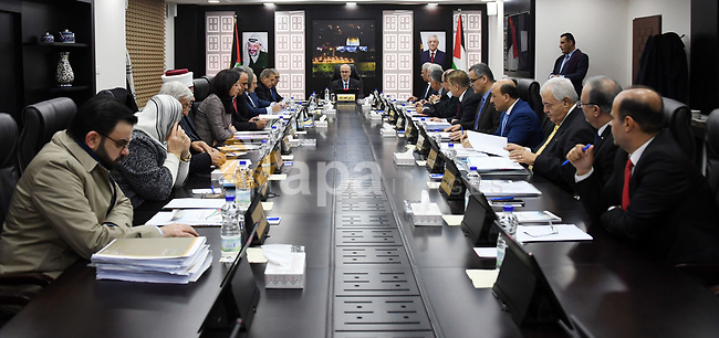 Palestinian Prime Minister Rami Hamdallah chairs a meeting with council of Ministers in the West Bank city of Ramallah on December 27, 2018. Photo by Prime Minister Office