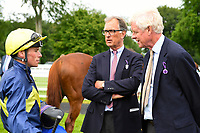 Jockey Kieran Shoemark talks with trainer of Polish, Roger Charlton (m) in the winners enclosure after winning The Sorvio Insurance Brokers Maiden Stakes (Plus 10) during Afternoon Racing at Salisbury Racecourse on 12th June 2018