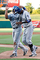 Hector Gomez (5) of the Tulsa Drillers is congratulated by Wilin Rosario (20) after hitting a home run during a game against the Springfield Cardinals at Hammons Field on July 18, 2011 in Springfield, Missouri. Tulsa defeated Springfield 13-8. (David Welker / Four Seam Images)