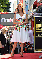 LOS ANGELES, CA. August 11, 2016: Roma Downey at Hollywood Walk of Fame Star ceremony for actress Roma Downey. <br /> Picture: Paul Smith / Featureflash