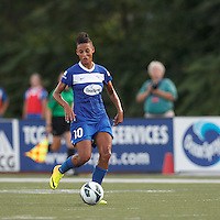 Boston Breakers forward Lianne Sanderson (10) brings the ball forward.  In a National Women's Soccer League (NWSL) match, Boston Breakers (blue) tied Western New York Flash (white), 2-2, at Dilboy Stadium on August 3, 2013.