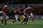 Munster fullback Felix Jones beats Dragons forwards Francisco Tetaz Chaparro and Cory Hill.<br /> RaboDirect Pro12<br /> Newport Gwent Dragons v Munster<br /> Rodney Parade - Newport<br /> 29.11.13<br /> ©Steve Pope-SPORTINGWALES
