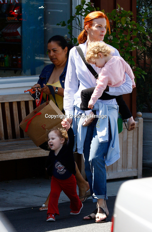.4-4-09..Marcia Cross leaving the Brentwood Market place near Los Angeles with kids  Eden & Savannah  ...AbilityFilms@yahoo.com.805-427-3519.www.AbilityFilms.com.