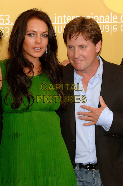 "LINDSAY LOHAN & EMILIO ESTEVEZ.Photocall for ""Bobby"" at the 63rd Venice International Film Festival, Venice, Italy..5th September 2006.Ref: PL.half length green dress.www.capitalpictures.com.sales@capitalpictures.com.©Phil Loftus/Capital Pictures"