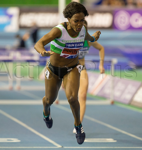28.02.2016. EIS Sheffield, Sheffield, England. British Indoor Athletics Championships Day Two. Tiffany Porter (Woodford G) leans forward as she crosses the finish line to win the 60m Hurdles British Title.