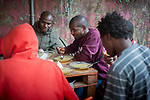 A group of African migrants have dinner in Lakaxita. Irun (Basque Country). August 30, 2018. Lakaxita is a self-managed socio-cultural space located in an occupied house, where volunteers have created a hosting network for migrants in transit who have already completed the 5-day period that can remain in public resources. This group of volunteers is avoiding a serious humanitarian problem Irún, the Basque municipality on the border with Hendaye. As the number of migrants arriving on the coasts of southern Spain incresead, more and more migrants are heading north to the border city of Irun. (Gari Garaialde / Bostok Photo)