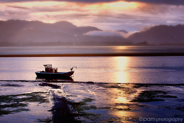 Lone fishing boat at sunrise on Tillamook Bay
