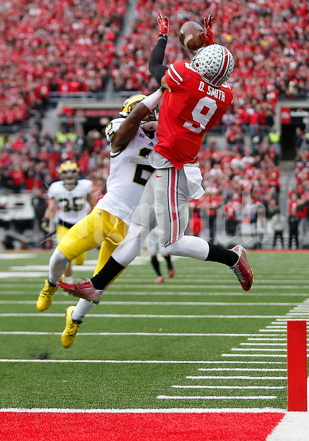 Ohio State Buckeyes wide receiver Devin Smith (9) fails to catch a pass under pressure from Michigan Wolverines defensive back Blake Countess (2) during the college football game between the Ohio State Buckeyes and the Michigan Wolverines at Ohio Stadium in Columbus, Saturday morning, November 29, 2014. The Ohio State Buckeyes defeated the Michigan Wolverines 42 - 28. (The Columbus Dispatch / Eamon Queeney)
