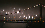 An annual fireworks display lit up the sky near one of the towers of the Bay Bridge in San Francisco at Piers 30/32 in San Francisco, California.