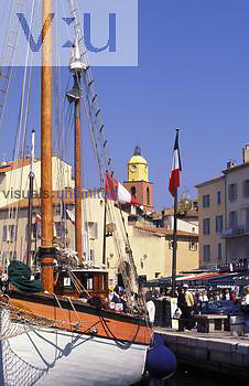 St. Tropez, sail boats in the harbour and the church tower. Provence, France