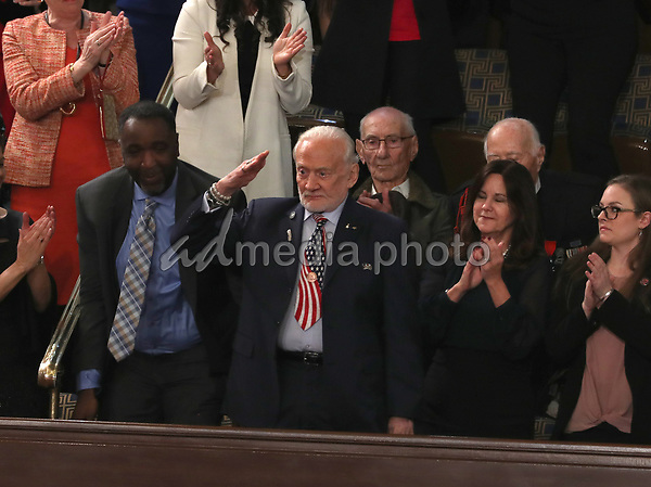 Former astronaut Buzz Aldrin salutes after being recognized as United States President Donald J. Trump delivers his second annual State of the Union Address to a joint session of the US Congress in the US Capitol in Washington, DC on Tuesday, February 5, 2019. Photo Credit: Doug Mills/CNP/AdMedia