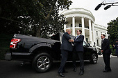 "United States President Donald Trump (L) talks to Ford Motor Company Vice President of U.S. Government Relations Curt Magleby (2nd L) in front of an F-150 pick up truck during the 2018 Made in America Product Showcase July 23, 2018 at the White House in Washington, DC. The White House held the showcase to ""celebrates every state's effort and commitment to American-made products, and will allow these companies to speak with senior Administration officials, including the President, the Vice President, members of the Cabinet, and senior staff.""  <br /> Credit: Alex Wong / Pool via CNP"