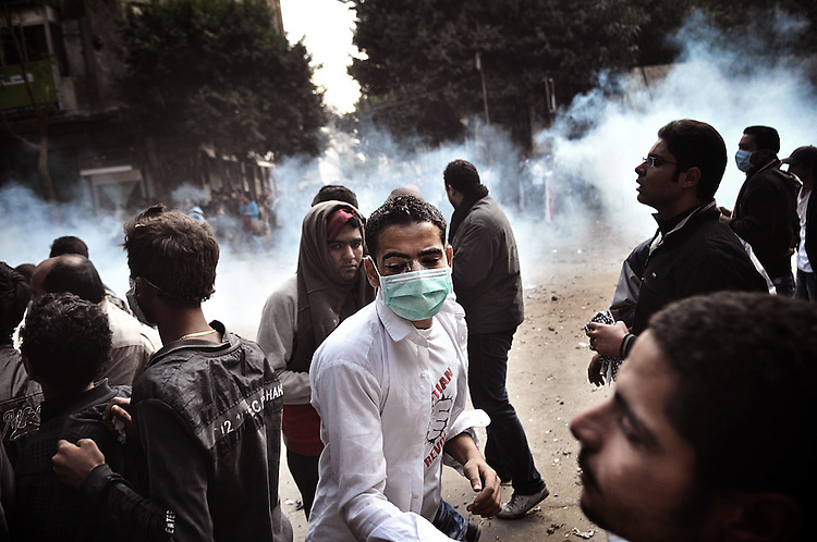 Riot police firing tear gas and rubber bullets stormed into Tahrir Square to dismantle a protest camp. Since the beginning of the protest, at least two people were killed and hundred were injured.
