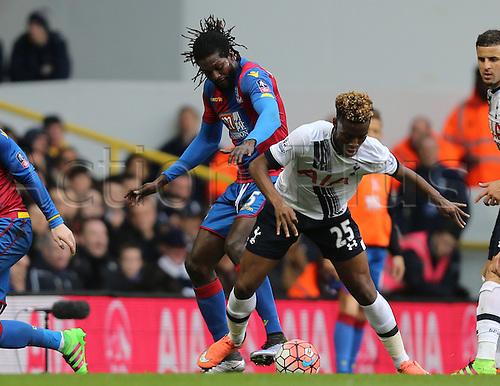 21.02.2016. White Hart Lane, London, England. Emirates FA Cup 5th Round. Tottenham Hotspur versus Crystal Palace. Emmanuel Adebayor and Josh Onomah battle for the ball