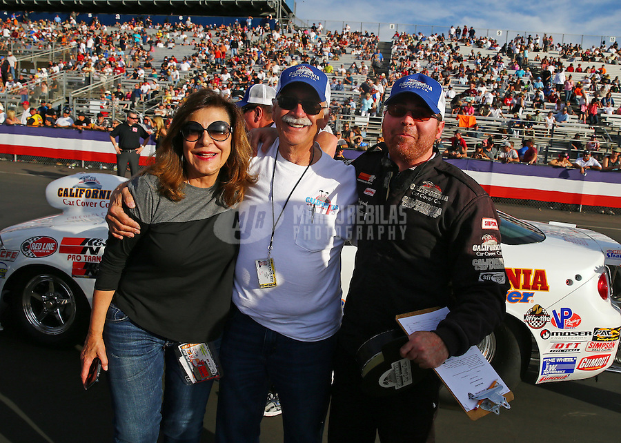 Feb 14, 2016; Pomona, CA, USA; NHRA super stock driver Jimmy DeFrank celebrates with father Jim DeFrank and his mother after winning the Winternationals at Auto Club Raceway at Pomona. Mandatory Credit: Mark J. Rebilas-USA TODAY Sports