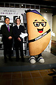 (L to R) Shusaku Higaki President of Asrapport Dining Co., Ltd., Melissa Lora, President of Taco Bell International and the restaurant's mascot character pose for the cameras during the pre-opening event for their first Japanese store located in Tokyo's Shibuya district, on April 20, 2015, Japan. The store includes Japan specific dishes like shrimp and avocado burrito and taco rice on its menu. It will open to the public on April 21st. The American Tex-Mex fast food restaurant has signed a franchise agreement with Asrapport Dining Co., Ltd. to operate Taco Bell branches in Japan. (Photo by Rodrigo Reyes Marin/AFLO)