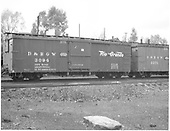 Side view of box car #3094 at Chama.  Coupled to box car #3371 (partially seen).<br /> D&amp;RGW  Chama, NM  1939